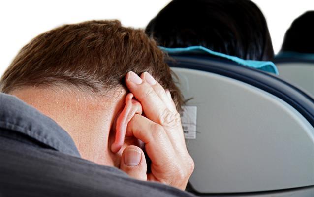 Bolest uší během přistávání letadla